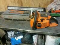 Chainsaw... chain saw.. wood timber trees logs blocks etc