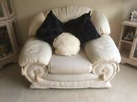 Cream 3 piece suite in good condition, includes a Settee and 2 Chairs