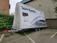 Brian James twin axle flat bed trailer