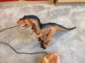 Moving dinosaur toy with lights and sounds