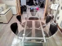 Rectangular glass dining table & 6 leather chairs for sale.