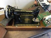 Vintage Singer hand crank sewing machine wooden case and key.