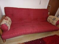 futon sofabed with Chinese style mattress and bolster cushions