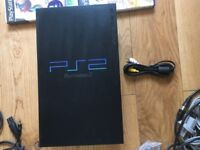 PS2 with memory card, 4 games and 3 microphones