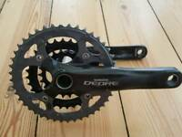 For sale is a Shimano Deore crankset.