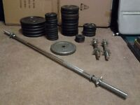 132.5 KG of various sized Weight Plates, 2 x Spin lock Dumbbell Bars and 1 x 4ft 6 inch Bar