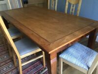 Wood dining table and six chairs