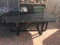 Large glass table seats 8