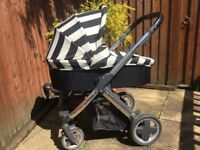 A used Oyster Vogue style pram includes rain cover