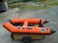 Zodiac 4 man inflatable dinghy, oars, transom seat and outboard motor