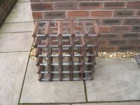 A 25 bottle metal and wood wine rack.