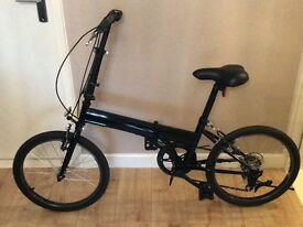 NEW fold up adult bike with carrying bag.