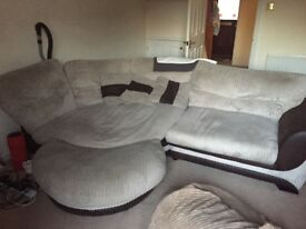 Cream and brown corner sofa excellent condition with extra foot stall feature