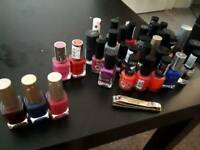 Many nail polishes and clipper