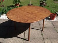 Round Wooden Extending Dining Room Table