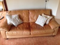 Large 3 seater leather sofa in tan. Very comfy