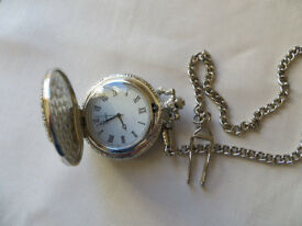 French hunter's pocket watch on chain. Silver coloured metal.