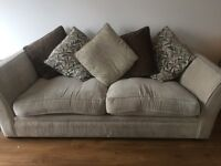 Beige fabric couch, under 2 years old. Bought brand new. Wooden legs, a deep comfortable couch