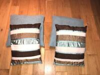 4 teal coloured cushions from Next