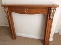 Wooden mantelpiece with marble-effect fire surround