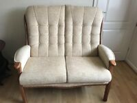 Immaculate high backed 2 seater sofa and chair. Solid wood frames.