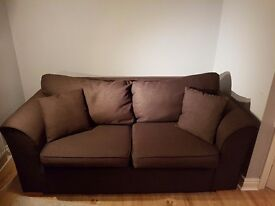 Sofa bed in chocolate brown.