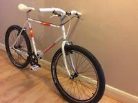 White Peugeot bike, single speed built on vintage frame with new components
