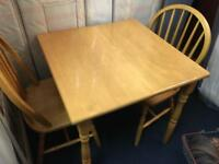 Beech Rubberwood square dining table & 2 chairs.