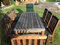 8-seater teak garden dining table, chairs and seat cushions from Swan of Hattersley