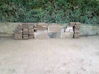 Paving bricks, stones, 3 bags of used soil and black drain pipe for free