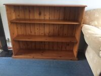 Bookcase pine. 121cm wide, 30cm deep, 95cm tall. And matching smaller shelf unit.