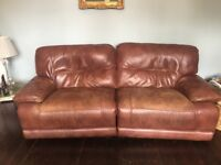Really comfortable brown leather three seater electric reclining sofa with matching armchair