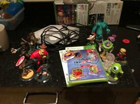 Disney infinity and infinity 2.0 with two portals and 12 characters for the Xbox 360
