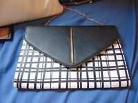 black and wight clutch/chain bag