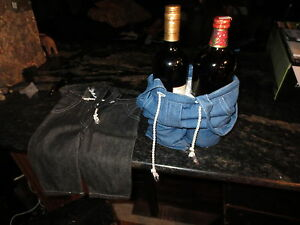 Two wine bottle jean carriers