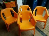 Four unused plasric garden chairs
