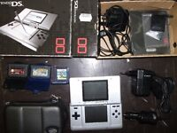 Nintendo DS with box and games