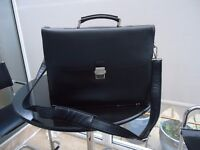 Davidt's Briefcase, large, black leather with front clasp, 8 pockets of storage, good condition