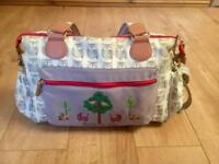 Pink lining nappy changing bag