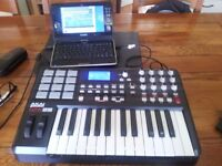 AKAI MPK25 midi controller keyboard with notebook pc loaded with music software.