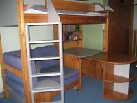 Stompa high sleeper bed includes sofa bed, extendable desk, book shelves and storage