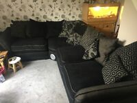Black and Grey scatter back corner sofa.
