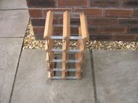 A small metal and wood wine rack.