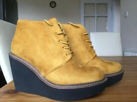 Gorgeous yellow wedge boots