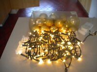 Christmas lights and set of gold coloured baubles