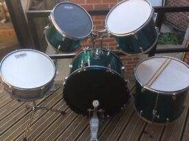 5 piece performance percussion drum kit and drumsticks. Excellent condition. Can deliver locally.