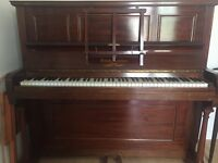 Free upright Brasted rosewood piano, please collect, would suit learners