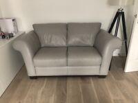 2x light grey leather 2 seat sofas (like new)
