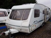 2002 Swift Conqueror 650 LUX 6 Berth Twin Axle Caravan with Twin POWRTOUCH Motor Movers
