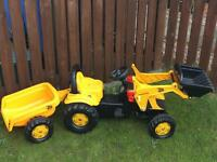 JCB yellow ride tractor with trailer